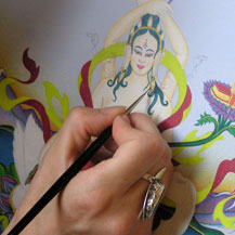Painting the thangka of the female Buddha Tara